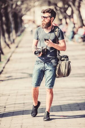 Content creator. Man bearded hipster photographer. Old but still good. Photographer hold vintage camera. Modern blogger. Manual settings. Photographer with beard and mustache. Tourist shooting photos