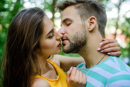 Passionate kiss concept. Giving kiss. Seduction and foreplay. Sensual kiss of lovely couple close up. Couple in love kissing with passion outdoors. Man and woman attractive lovers romantic kiss