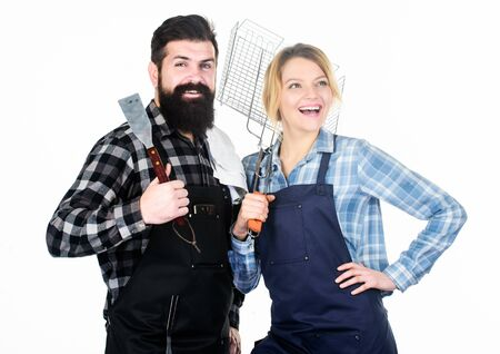 Picnic and barbecue. Man bearded guy and girl ready for barbecue white background. Backyard barbecue party. Family cooking grilled food. Cooking together. Couple in love getting ready for barbecue