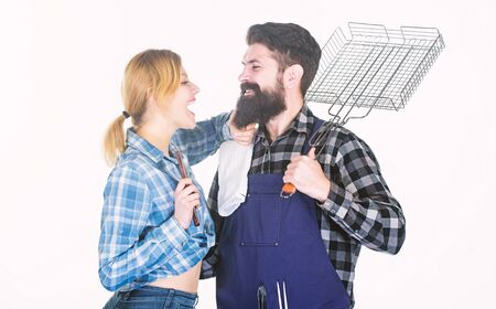 Perfect day for barbecue. Man bearded hipster and girl. Preparation and culinary. Picnic barbecue. food cooking recipe. Couple in love hold kitchen utensils. Family weekend. Tools for roasting meat Zdjęcie Seryjne