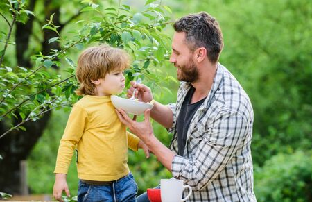 Healthy nutrition concept. Feeding baby. Menu for children. Family enjoy homemade meal. Father son eat food and have fun. Nutrition habits. Little boy and dad eating. Nutrition for kids and adults