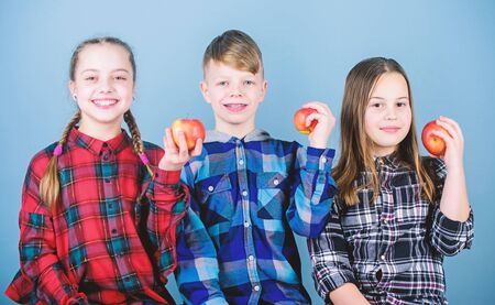 School snack time. Having tasty snack. Boy and girls friends eat apple snack. Teens with healthy snack. Apple fruit has numerous benefits. Vitamin nutrition concept. Eat fruit and be healthy