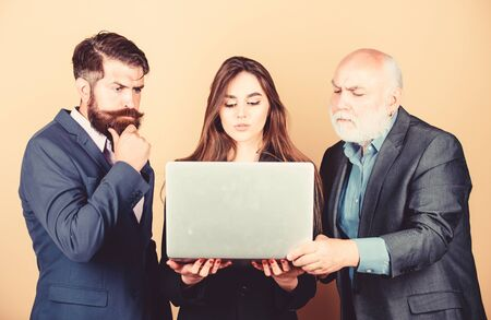 Really busy. Online work. business partners discuss problem. confident mature men with laptop. woman secretary looking in computer. businessmen team. communication meeting. modern technology Stok Fotoğraf