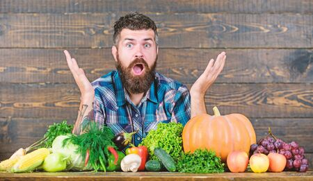 surprised man chef with rich autumn crop. organic and natural food. happy halloween. seasonal vitamin food. Useful fruit and vegetable. harvest festival. bearded mature farmer with crop. crop concept