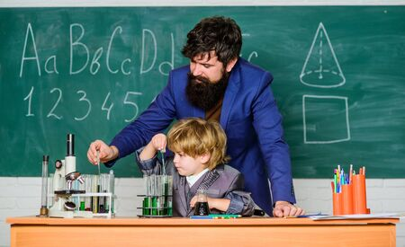 small boy with teacher man. solution in research laboratory. Genetic research. Wisdom. Back to school. son and father at school. Pharmacy and chemistry theme. School curriculum