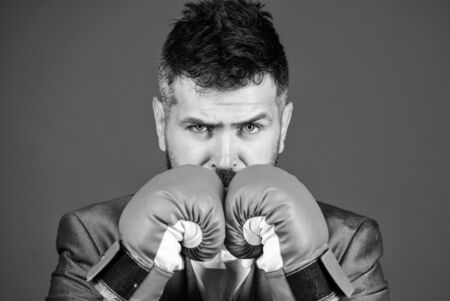 Criminal defense lawyer planning out strategies. Businessman wear boxing gloves. Best criminal defense lawyer strategies. Attack and defense concept. Achieve success. Tactics proven to work Stock Photo