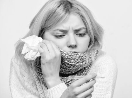 Seasonal flu concept. Woman feels badly. How to bring fever down. Fever symptoms and causes. Sick girl with fever. Girl sick hold thermometer and tissue. Measure temperature. Break fever remedies