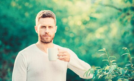 breakfast refreshment time. drink tea outdoor. morning coffee. healthy lifestyle. nature and health. ecological life for man. man in green forest. mature man with cup of tea. Morning vibes