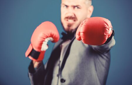 knockout and energy. Fight. businessman in formal suit and bow tie. Business and sport success. powerful man boxer ready for corporate battle. bearded man in boxing gloves punching. no pain no gain