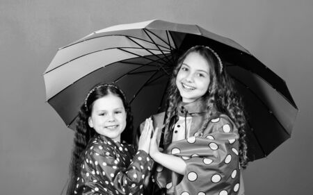 rain protection. Rainbow. autumn fashion. happy little girls with colorful umbrella. cheerful hipster children, sisterhood. family bonds. Little girls in raincoat. Any weather is good Stockfoto