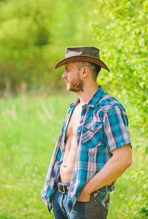sexy farmer relax. farming and agriculture cultivation. time for break. Eco farm. Harvest. earth day. Eco living. muscular ranch man in cowboy hat. Skillful gardener is planting flower at greenhouse