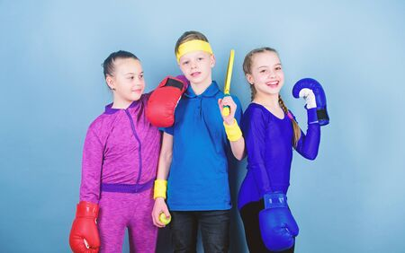 Fitness energy health. punching knockout. Team sport success. workout of small girls boxer and boy in sportswear. Happy children in boxing gloves with tennis racket and ball. boxing Imagens