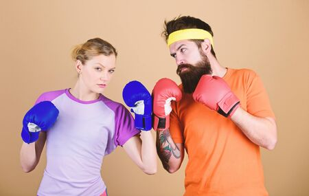 Be careful. Boxing sport concept. Couple girl and hipster practicing boxing. Sport for everyone. Amateur boxing club. Equal possibilities. Strength and power. Man and woman in boxing gloves