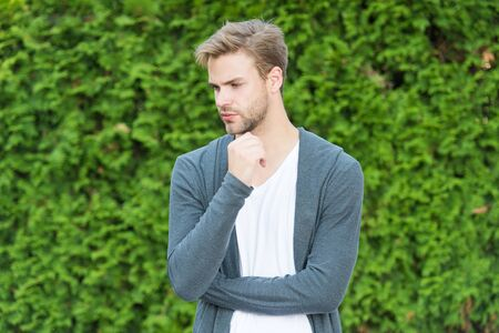 Barbershop service. Handsome macho. Fundamentals of good dressing. Handsome man unshaven face and stylish blond hair. Handsome caucasian man nature green background. Bearded guy casual style Reklamní fotografie