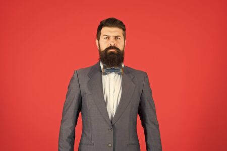 Fashion concept. Businessman or host fashionable outfit red background. Formal outfit. Confident posture. Man bearded hipster wear classic suit outfit. Take good care of suit. Elegancy and male style