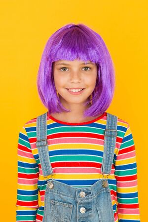 Anime fan. Cosplay kids party. Child cute cosplayer. Cosplay outfit. Otaku girl in wig smiling on yellow background. Cosplay character concept. Culture hobby and entertainment. Happy childhood Stock Photo