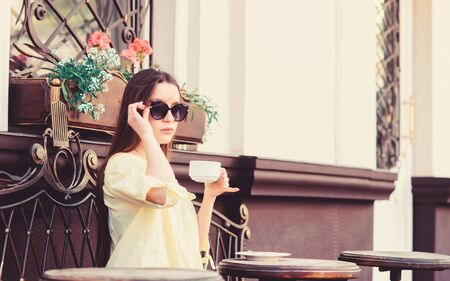 morning coffee. Waiting for date. girl relax in cafe. Business lunch. summer fashion. Meeting in cafe. good morning. Breakfast time. stylish woman in glasses drink coffee. Enjoying morning coffee