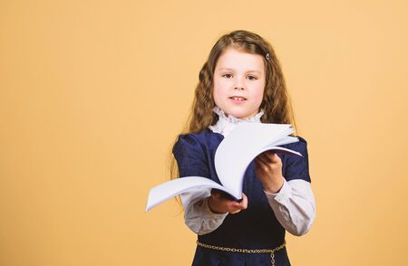 Knowledge day. Serious about studying. Schoolgirl adorable child. Childhood and upbringing. Knowledge and information. Small kid study. School life. Education concept. Basic knowledge. Back to school Stock Photo