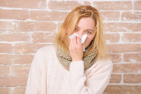 Sneezing just keep coming. Sick woman blowing her nose in napkin. Pretty girl sneezing of seasonal influenza virus. Cute woman caught nasal cold or allergic rhinitis. Suffering from flu or allergy 写真素材