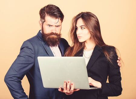 Discussing progress. Woman and guy colleague working together. Business plan. Business lady and director or boss surfing internet. Business meeting. Man bearded manager show financial report laptop Reklamní fotografie