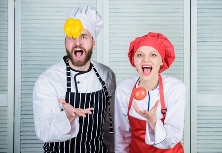 Just for fun. man and woman chef in restaurant. Family cooking in kitchen. Dieting and vitamin. culinary cuisine. happy couple in love with healthy food. vegetarian. cook uniform