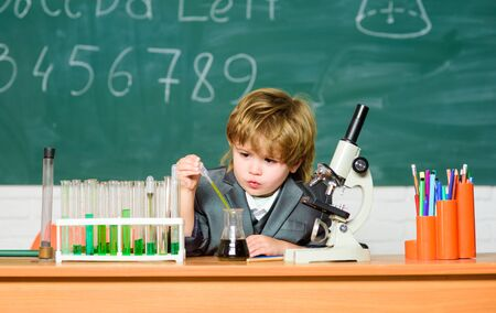 science experiments with microscope in lab. Educational research. biology equipment. little boy at lesson. Back to school. Little kid learning chemistry in school laboratory. Discovering cure Stock fotó