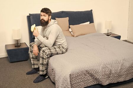 Calorie snack. Man bearded hipster sleepy face pajamas waking up bedroom interior. Healthy lifestyle. Rest and relax. Problem with early morning awakening. Get up early. Tips for waking up early