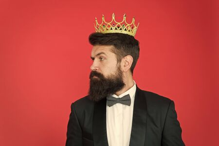 vip. Big boss. Formal event. King crown. Formal wear male fashion. Egoist. Businessman in tailored tuxedo and crown. Vip man in suit. Bearded man in tuxedo and bow tie at vip party. vip client Foto de archivo