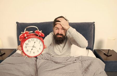 Hate this noise. Problem with early morning awakening. Get up early. Tips for waking up early. Man bearded hipster sleepy face waking up. Daily schedule for healthy lifestyle. Alarm clock ringing