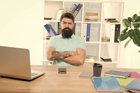 Employee of the month. Man indifferent boss with golden crown sit in office. Superiority and self confidence. King boss of office. Serious boss at work place. Office life concept. Best worker award