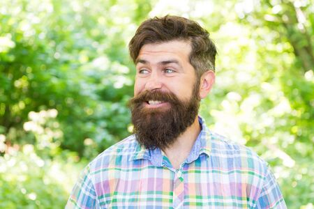The joy of best hairstyle. Bearded man smiling with fashion hairstyle in summer. Happy hipster with trendy facial hairstyle. Caucasian guy wearing designer hairstyle outdoor