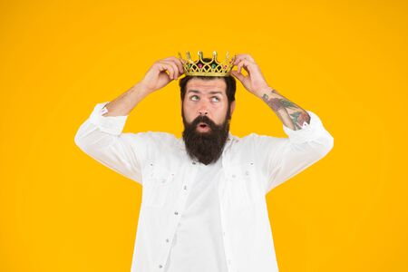 Sense of self importance. Handsome bearded guy king. Holiday carnival celebration. Superstar concept. Bearded man king costume party. Superiority complex. Love yourself. King of party. Costume party Stock Photo - 128936176