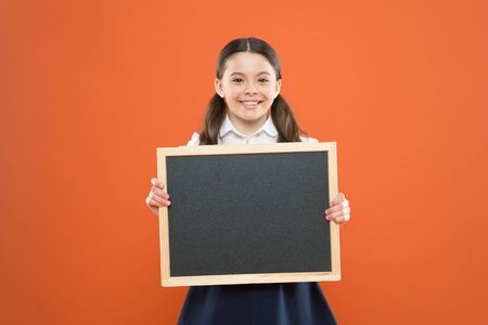 Informing kids changes in school life. School girl pupil hold blackboard copy space. School news concept. Check out responsibilities of pupils. Topic of todays lesson. School schedule information