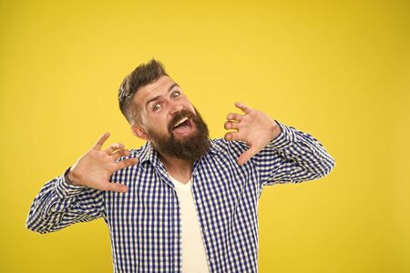 Feeling awesome. Beard fashion and barber concept. Man bearded hipster stylish beard yellow background. Barber tips maintain beard. Beard and mustache care. Hipster appearance. Emotional expression