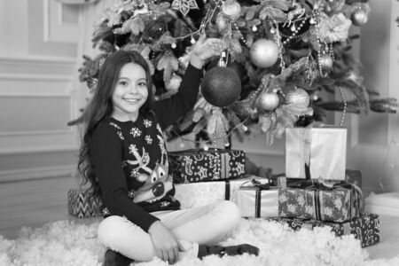 small happy girl at christmas. little child girl likes xmas present. Happy new year. Christmas. Kid enjoy the holiday. The morning before Xmas. New year holiday. Come Santa Clause and don t delay Stock Photo
