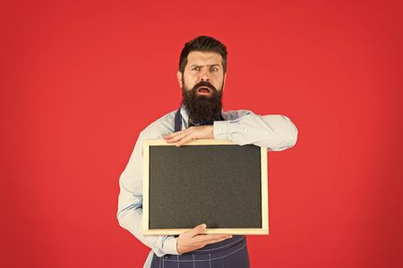 Technical issues. Hipster bartender show blackboard copy space. Hipster restaurant staff. Hipster informing you. Man bearded bartender or cook in apron hold blank chalkboard. Price list concept