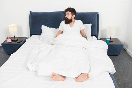 asleep and awake. Too early to wake up. bearded man hipster sleep in morning. mature male with beard in pajama on bed. brutal sleepy man in bedroom. energy and tiredness. Sleepy and handsome