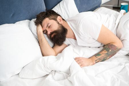 Need some rest. Sleep disorders concept. Man bearded hipster having problems with sleep. Guy lying in bed try to relax and fall asleep. Relaxation techniques. Violations of sleep and wakefulness 写真素材