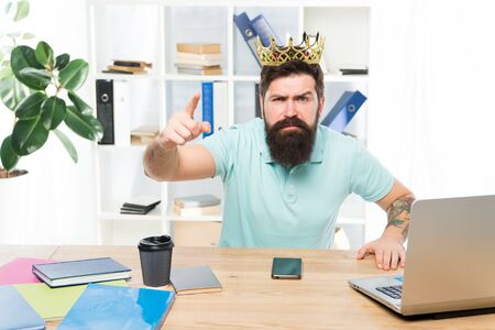 Issuing decree. Office is my kingdom. King of office. Man bearded businessman wear golden crown. Top manager head office. Boss enjoying glory. Head office and ceo concept. Chief executive officer Stock Photo