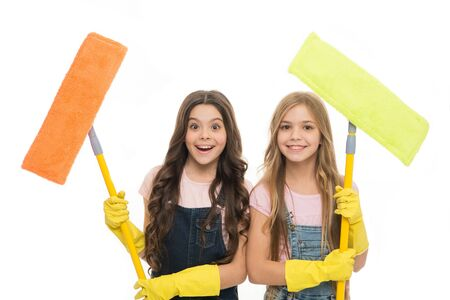 Adorable clean freaks. Cute girls holding mops for cleaning floor. Small cleaning ladies. Little cleaners with modern cleaning tools. Sanitation and cleaning service Archivio Fotografico