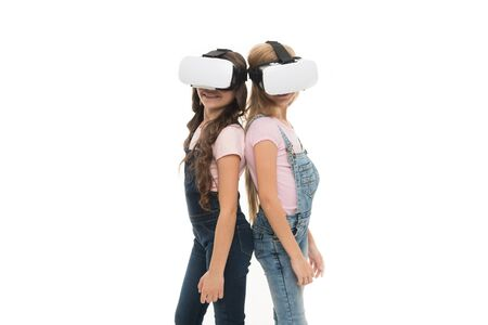 Taking advantage of this new technology. Adorable little kids using VR technology for learning and playing. Cute small children experiencing innovative technology. The technology is there, copy space Stock fotó