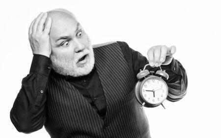 Mature bearded man with alarm clock.