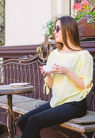 Stylish woman in glasses drink coffee.