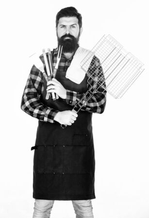 Bearded hipster wear apron for barbecue.