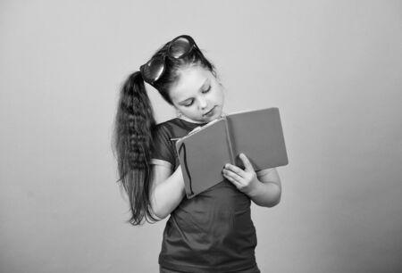 Small beauty girl write her memories Фото со стока