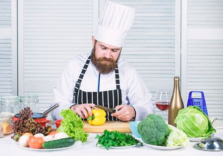 Basic cooking processes. Man master chef or amateur cooking food. Sharp knife chopping vegetable. According to recipe. Prepare ingredient for cooking. Useful for significant amount of cooking methods.