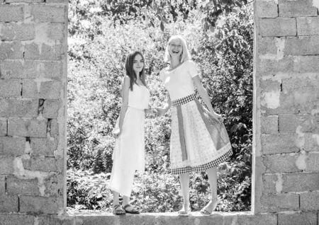 Friendship concept. Girls friends summer dress outfit nature