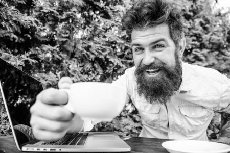 happy man working on laptop. brutal bearded hipster at coffee break. office worker. Successful businessman. agile business. Business success. perfect deal. Making great decisions. Banco de Imagens