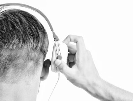 Man listening music headphones white Stock Photo - 129262533