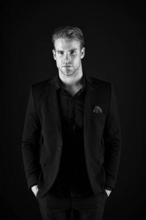 Man handsome well groomed macho on black Stock fotó